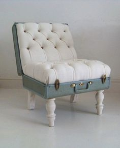 Upcycled old suitcase; larger for people-sized chairs, smaller for small dog beds or ottomans