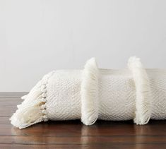 Cozy fringe brings soft texture to this throw