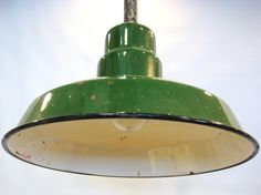 "i like the farmy- ""pie cooling in a window"" feel of this. Antique Green Enamel Metal Hanging Light Fixture"