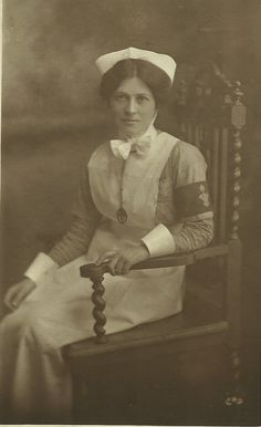 """Unidentified Nurse circa 1914. She wears the badge and armband for the """"Queen's District Nursing Service"""" ~"""
