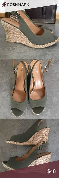 NEW! PEEP TOE SANDAL WEDGE Brand new peep toe olive wedges.  Never worn, olive canvas material, with tan lining, cork wedge with Adjustable buckle closure.   Never worn, brand new, no box.  Size 8.5.  Refer to pics questions welcomed. Diba Shoes Sandals