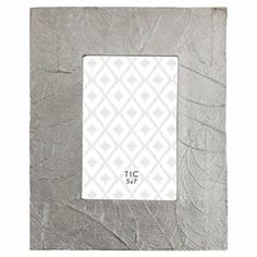 """Highlight your favorite family photos in natural-inspired style with this eye-catching picture frame, featuring a raised leaf motif for a touch of texture.  Product: Picture frameConstruction Material: AluminumColor: Gray Features:  Raised leaf motifHolds one 5"""" x 7"""" photoDimensions: 10"""" H x 8.5"""" W x 1"""" D"""