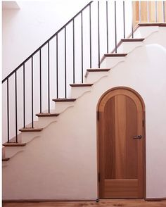 Iron Stair Railing with Wood Treads.  Storage Closet created under Stairwell.  Note: Decorative Wood Trim Steps.