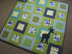 Versatile block quilt that can be easily made into a memory quilt by adding pictures in the blocks or by making the blocks out of children's outfits. It is also possible to change the giraffe into a different animal.