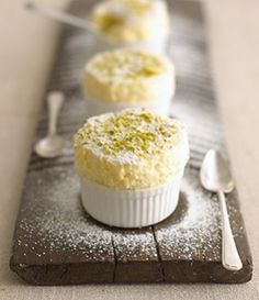Lemon Souffles.  Don't tell me those are pistachios on top????  Wow