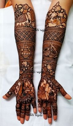 Looking for A wonderful traditional mehndi design with a bride & groom portrait. Browse of latest bridal photos, lehenga & jewelry designs, decor ideas, etc. on WedMeGood Gallery. Wedding Henna Designs, Engagement Mehndi Designs, Latest Bridal Mehndi Designs, Mehndi Designs 2018, Stylish Mehndi Designs, Indian Wedding Mehndi, Rajasthani Mehndi Designs, Dulhan Mehndi Designs, Legs Mehndi Design