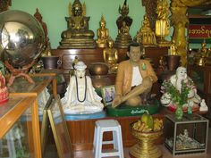 Life size model of a Human with Buddha statues and Buddha relics in Monastery near Mandalay. Statues such as this are related to Burmese legends.