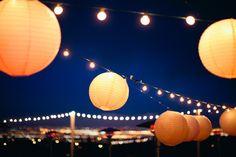 a sky full of paper lanterns