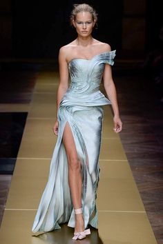 Atelier Versace Fall 2016 Couture: Futuristic one shoulder off shoulder dress with ruffle details and a thigh high slit!