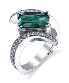 Mark Schneider Design Graceful Tourmaline Ring. Beautiful blue-green tourmaline, accented with 0.57ctw of white diamonds.