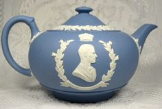 This is a Wedgwood, England blue jasper or jasperware teapot made for the coronation of Queen Elizabeth II of England in 1953. The gorgeous royal commemorative teapot has white applied laurel leaf and