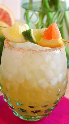 This inventive Margarita is made with ginger infused coconut water and fresh homemade sweet and sour mix for an incredible flavor profile everyone will LOVE. (Recipe included by the pitcher or half pitcher.) The perfect party cocktail for summer cookouts!