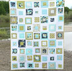 Modern Meadow quilt from Cluck Cluck Sew. I love her use of colors and her patterns are very easy to follow.