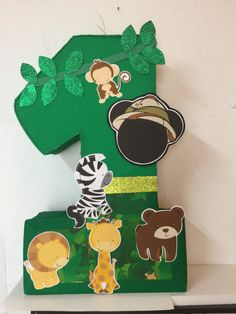 Safari number mickey mouse Pinata. mickey mouse Safari birthday Party. Jungle birthday Pinata