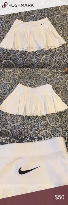 Nike fit-dry Tennis Skirt Amazing tennis skirt! Stretchy, fitted, no shorts/bloomers underneath. Great condition !! Nike Skirts