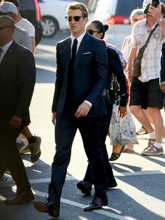 Miles Teller in a navy Gucci suit