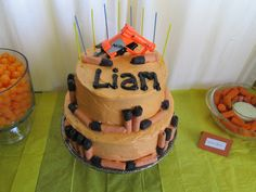 Nerf Wars / Birthday - cake with real gun and edible darts. Snacks are carrot darts and cheese puff bullets.