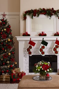 Spruce up the living room with Christmas greens, faux poinsettias and fresh red and green flowers. Add candle rings on the mantel for a festive touch.