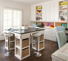 Fantastic homework room/office with a bar height square desk with drawer, open shelves with woven cubbies and room for three modern white and chrome adjustable barstools. Light linen walls pair with white wooden window blinds and dark hardwood floors.