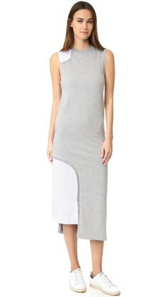 Mesh panels trim asymmetrical cutouts, adding a sporty addition to this Cheap Monday T-shirt dress. Crew neckline. Sleeveless. Unlined.