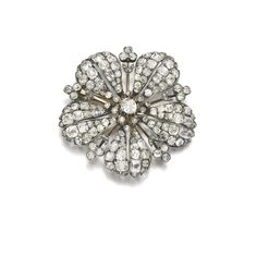 DIAMOND BROOCH, LATE 19TH CENTURY Of flower design set with circular-cut and rose diamonds.