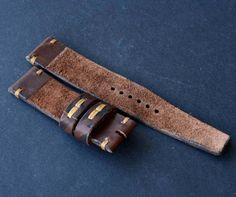 22/22 brown leather watch strap handmade 100% handmade leather strap watch is made of premium quality leather. Stitched entirely by hand very high quality waxed thread. Edges waxed natural Carnabua wax.  -Size on watch 22mm -Size on buckle 22mm -Long part 130mm -Short part 80mm -Thickness about 3 mm -Color brown  Made in one piece. Will be perfect and reliable decoration for your wrist watch. I hope you enjoy. !!!Sold only strap, the watch and buckle not included.