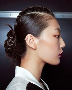 Centre braid pulled back into a low bun.