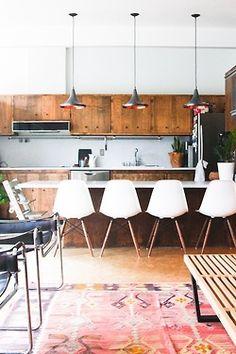 Eames stools, tom dixon pendants, kilim rug
