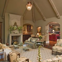 love the beams, comfort & especially the red kitchen... Jack Arnold Design Family Room.