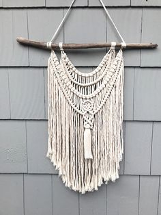 ****This piece has been sold, but Jeanie will custom make a similar one just for you.***** All of the wall hangings here at Driftwood Family Studios are handcrafted with love by Jeanie, our fiber artist. Jeanie designs and creates her pieces from her studio in Davenport, Iowa. She