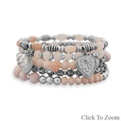 Set of 5 Silver Tone Multicharm Fashion Stretch Bracelets with Pink Beads        Price: $36.95