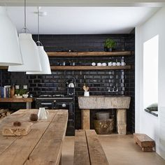 Reclaimed materials run throughout this Northumberland farmhouse belonging to Paul Priestman. The kitchen sink, for instance, is made from a stone trough.
