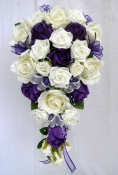 brides winter rose pearl theme bouquet. I really like the cascade. Another Idea for my navy/silver scheme