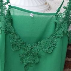 HPSheer Green Lace Tank Top Beautiful sexy and romantic tank tops This is shamrock green neckline & sheer bottom! ImportantSizes run two sizes smaller from China !  This listing is for an tag size L but fits like a Small#Medium !   RUNS SMALL        In photo I'm wearing an XXXL and I'm usually an XXL it looks good on top but it snug in stomach and shorter then I like in back! Great quality very pretty sexy and beautiful !  Length 55cm Bust 96cm Boutique Tops Tank Tops