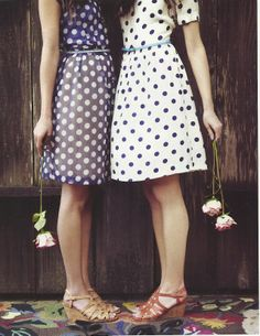 white on navy and navy on white polka dot dresses. I think I'll go with the white on navy.