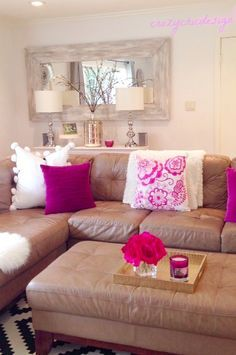 Add a little cheer to your space with bright fuchsia and pink! Pair it with soft, white textural pillows and throws to act as neutrals. Mix and match different pillows styles and sizes for visual interest. HomeGoods Sponsored Pin.