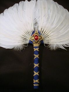 """Royal Renaissance feather fan:natural white w blue/gold trim and large """"ruby"""" jewel"""