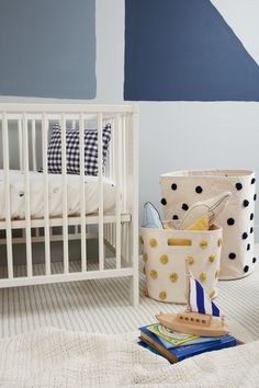 Sailor Nursery storage, brought together with our organic cotton sailor print crib sheet.