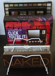 Use a magazine rack to bring order to stacks of big palettes. | 14 Incredibly Simple Ways To Organize Your Makeup