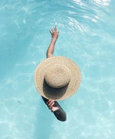 relaxing in the water with hat