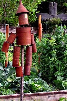 Tin Can Scarecrow! - it would be fun to make the arms and legs dangle so they could be wind chimes...maybe even use a couple of cow bells for the feet?