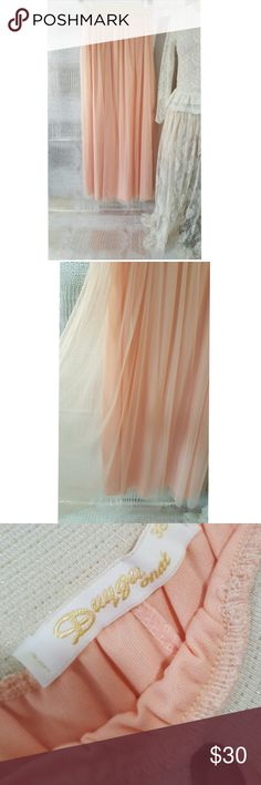 Tutu tulle skirt peach maxi length stretch waist Tutu tulle skirt peach maxi length stretch waist     Pre owned condition *******All items are in pre owned condition, Nothing, unless noted , is brand new **** please ask questions For sale in my posh closet  LINK IN MY BIO Dugyu Skirts Maxi