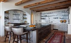 This kitchen used 8x8 reclaimed hand hewn hardwood barn beams. The mortise pockets are left unfilled. Products Used: Hand Hewn Barn Beams Credits: Architect Paul Brant Williger
