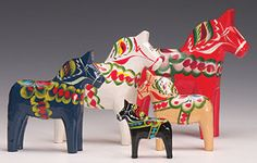 Dala Horses from the Nusnäs-Mora area first appeared with their familiar bright decoration in the 1800's when the kurbit, or flower patterned saddle, was regularly added to them. This design comes from the Biblical story in which Jonah sat outside the city of Ninevah and the Lord caused a Kurbit, or gourd vine, to grow up beside him to protect him from the desert sun.