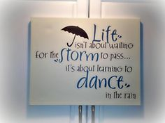 Life isn't about waiting for the storm to pass... it's about learning to dance in the rain Vinyl Decor from Uppercase Living (www.HangOnEveryWord.net)