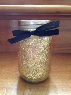 Gold glitter mason jar organizer.