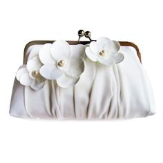 Unique, simple design ,handmade  clutch, ideally for Bride or Bridesmaids..  Color: light ivory    This clutch is lined with  polyester lining.    ...