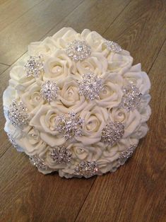 Best 12 Ivory Rose Brooch Bouquet Made with 30 x foam roses with diamante centres. Bouquet contains 12 alloy, rhinestone and pearl brooches, various sizes between and Roses have diamante pin centres. Bouquet measures 12 inches across Crystal Bouquet, Wedding Brooch Bouquets, Bling Wedding, Dream Wedding, Purple Wedding, Wedding Flowers, Broschen Bouquets, Purple Bouquets, Bridesmaid Bouquets