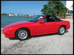 1988-1989 Mazda RX-7 Convertible. As the 80's progressed, the Mazda RX-7 was slowly moving away from it's more simple roots and making a name for it's self as a serious sports car. It would soon become one of the greatest sports cars ever built. In 1988 Mazda finally released a convertible version of it's popular RX-7. This car had been dying to have an open top model and Mazda delivered!