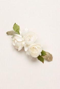 Fresh roses with realistic soft petals make for the perfect wedding day hair accessory. Crystal centers and tulle accents add that bridal touch!  Imported.